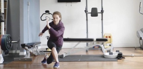 Trainer doing a curtsy back lunge